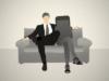 man with arm around smartphone on sofa